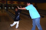 During The Andrew Hicks Foundation bowling event, Mentor Alex is giving his kid Mubarak a high five after knocking down some pins when he threw his bowling ball. Photos taken by © Samantha Nugent on March 10, 2012 in Downingtown, Pa.